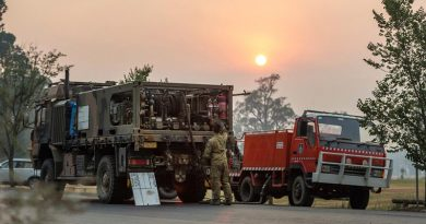Private Richard Crisp from the Australian Army's 2nd Combat Engineer Regiment conducts morning checks and prepares to refuel a NSW Bush Fire Service vehicle near Tumut, NSW. Photo by Lance Corporal Brodie Cross.