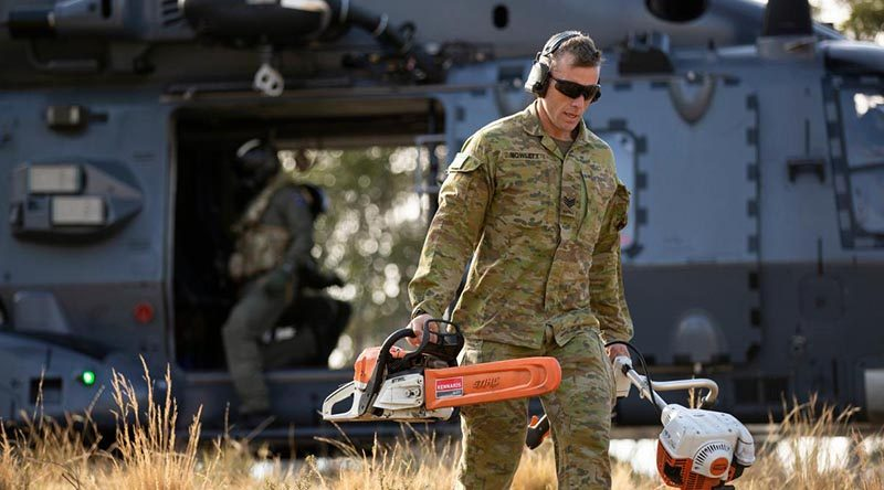 Sergeant Joshua Howlett, 7RAR, disembarks a Royal New Zealand Air Force NH90 to conduct land clearing and fuel reduction on Brindabella Mountain, west of Canberra. Photo by Signaller Robert Whitmore.