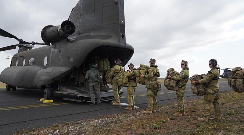 ADF medical personnel board a Singaporean Chinook at RAAF Base East Sale for a ferry flight to Mallacoota. Singapore Armed Forces photo.