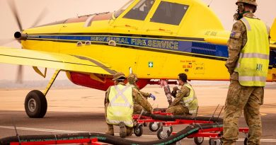 Soldiers from the 1st/19th Battalion, Royal New South Wales Regiment, refill fire retardant solution for a New South Wales Rural Fire Service plane in Canberra during Operation Bushfire Assist 19-20. Photo by Signalman Robert Whitmore.