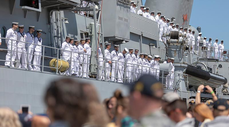 Officers and sailors on HMAS Toowoomba line the upper decks as to farewell family, friends and colleagues as the ship departs for Operation Manitou from Fleet Base West, Western Australia. Photo by Leading Seaman Ronnie Baltoft.