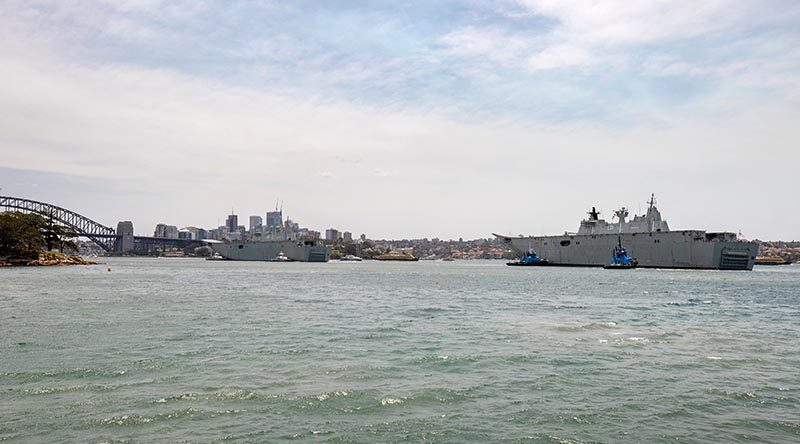 HMAS Adelaide returns home to Fleet Base East in Sydney after taking part in Operation Bushfire Assist 19-20, while HMAS Canberra prepares for a starring role in Australian Day celebrations near the Sydney Harbour Bridge. Photo by Leading Seaman Chris Szumlanski.