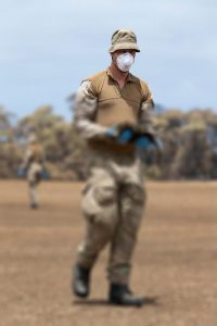 """New Zealand Army sappers from the 2nd Engineer Regiment collect dead wildlife on Kangaroo Island. Defence said, """"This image has been digital manipulated due to the sensitive nature of the subject"""". Photo by Corporal Tristan Kennedy."""