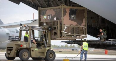 No. 23 Squadron air movements personnel load an Australian Army 6th Engineer Support Regiment water purification system on to a C-17A Globemaster at RAAF Base Amberley, destined for Kangaroo Island off South Australia. Photo: Corporal Jessica de Rouw.
