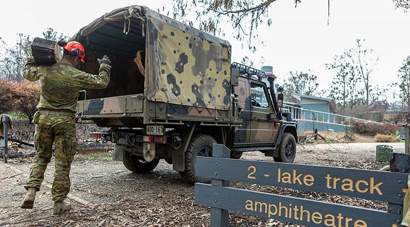 Corporal Travis Ward, 6RAR, loads a G-Wagon with debris at the Eurobodalla Regional Botanic Gardens, NSW. Photo by Corporal Dan Pinhorn.