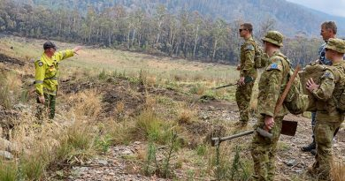 Soldiers from 6RAR are briefed by Scott Seymour from the ACT Environmental Services Agency before laying sediment traps in water-flow lines of the Corin Dam catchment in Namadgi National Park during Operation Bushfire Assist. Photo by Corporal Dan Pinhorn.