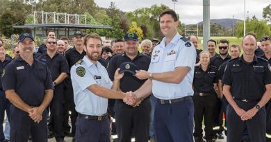 ADFA Director Education and Training Group Captain Jeff Howard presents Queensland Fire and Emergency Services officer Sam Eitz with an ADFA cap as a token of friendship before ADFA's firefighter-guests left for home. Photo by Corporal Dan Pinhorn.