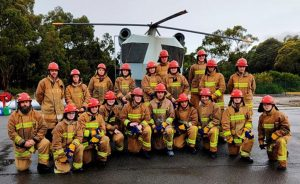 Australian Navy Cadets and staff in fire-fighting gear at the Bell Bay fire-training grounds.