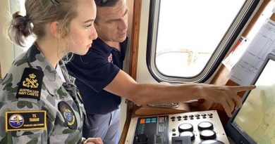 An Australian Navy Cadet at the helm of an Australian Maritime College training vessel during the inaugural ANC Maritime Skills Camp.