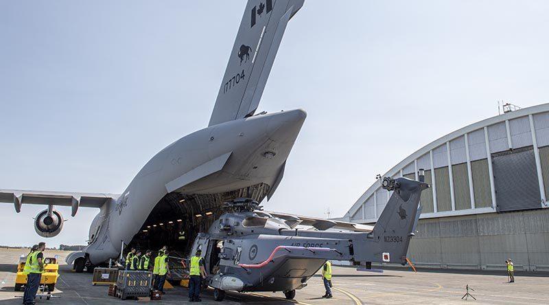 The first of three NH90s is returned to RNZAF Ohakea via RCAF CC-177 Globemaster. NZDF photo.