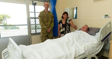 Chaplain Derek Croser with Jodie Meikle, Steven Childs – and 'the bed'.
