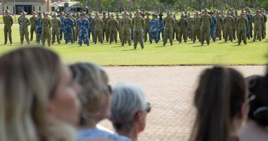 Friends and family watch a parade for deploying ADF personnel at Robertson Barracks, Darwin, NT. Photo by Petty Officer Peter Thompson.