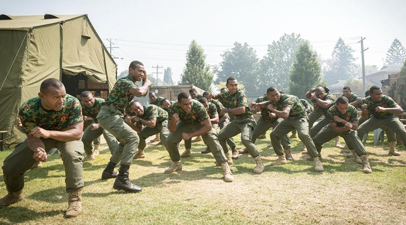 Soldiers from the Republic of Fiji Military Forces perform a cultural dance to welcome students visiting from Newmerella Primary School as part of a visit to the Orbost Football Oval, headquarters for the assistance effort during Operation Bushfire Assist 19-20 in Victoria. Photo by Leading Aircraftman John Solomon.