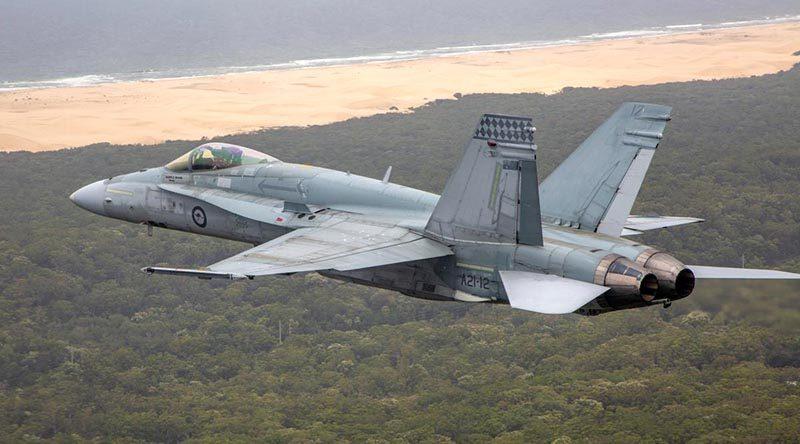An F/A-18A Hornet over the Western Australian coast. Photo by Corporal Craig Barrett.
