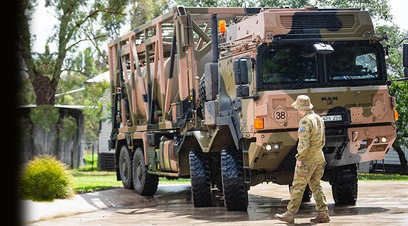 Australian Army soldier Lance Corporal Lewis James from the 3rd Combat Engineer Regiment, guides Corporal Steven Wilson from the 3rd Combat Service Support Battalion driving a MAN HX77 water resupply module vehicle in support of Operation Bushfire Assist 19-20. Photo by Private Madhur Chitnis.