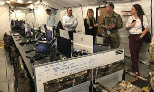 US Army Colonel John Conklin, chief of staff of the International Maritime Security Construct, explains the salubrious headquarters of the IMSC to reporters – 4.01pm 25 Nov 2019.