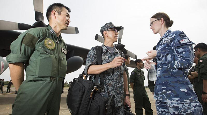 Flight Lieutenant Rebecca Marshall speaks with Japan Self-Defense Force personnel at RAAF Base Richmond. Photo by Corporal David Said.