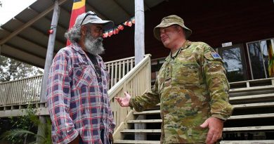Worimi man Captain Shane James speaks with Yuin elder Uncle Glenn Campbell at the Merrimans Local Aboriginal Land Council. Photo by Sergeant Max Bree.