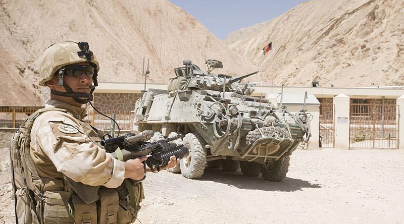 A New Zealand soldier and NZLAV on patrol in north-east Bamyian province, Afghanistan. NZDF photo.