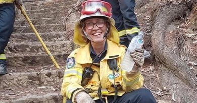 Squadron Leader Del Gaudry takes a rest from the front line in her other role as a volunteer firefighter, in the Blue Mountains.