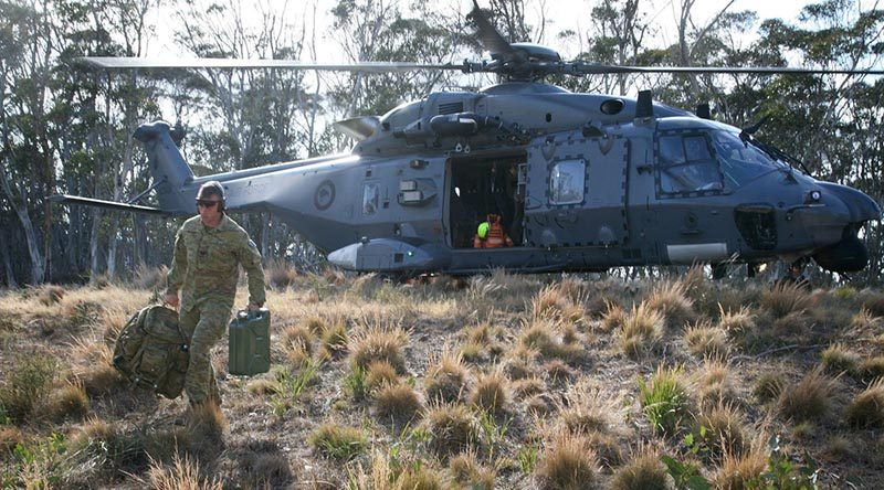 Sergeant Joshua Howlett carries equipment from a 3 Squadron, Royal New Zealand Air Force, NH-90 helicopter in Namadgi National Park, west of Canberra city. Photo by Major Cameron Jamieson.