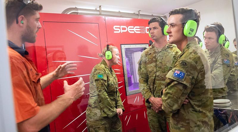 Australian soldiers from Darwin-based 1st Combat Service Support Battalion are instructed on the capabilities of SPEE3D printing. Photo supplied.