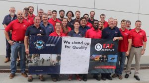 Staff from TAE Aerospace (blue shirts) and Pratt & Whitney (red) celebrate the first F135 maintenance outside the USA, in Queensland. Photo supplied by TAE Aerospace.