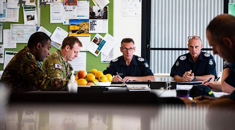Captain Levi, of the PNG Defence Force, and Lieutenant Scott Bowers in a meeting with members of Victoria Police at the Swift Creek Incident Control Centre during Operation Bushfire Assist. Photo by Private Madhur Chitnis.