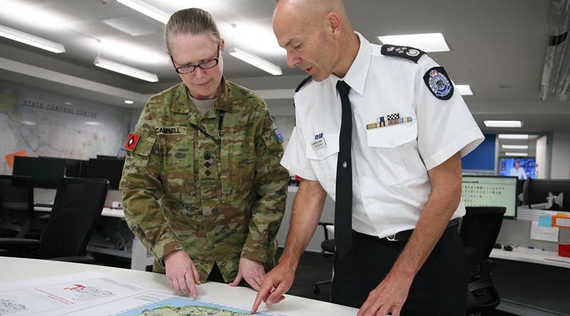 Emergency Management Victoria's Commissioner Andrew Crisp discusses operations in south-east Victoria with Colonel Michelle Campbell at the State Control Centre in Melbourne. Photo by Major Cameron Jamieson.