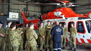 Matt Doyle, an Air Ambulance pilot, discusses the AgustaWestland AW139 helicopter with Air Force Cadets from 413 Squadron, Warrnambool. Photo by PLTOFF(AAFC) Jane McDonald.