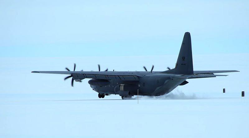 An RAAF C-130J Hercules lands at Wilkins Runway, Antarctica. Photo by Christopher Burns, Australian Antarctic Division.