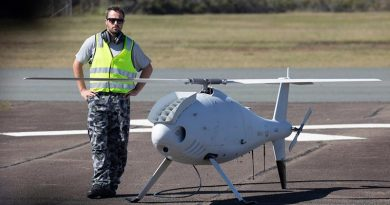 Petty Officer Aviation Technician Avionics Rodney Ferreira, stands by the Schiebel S-100 Camcopter before a flight at Jervis Bay airfield. Photo by Chief Petty Officer Cameron Martin.