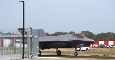 A35-009 taxis through a fence at its home compound at RAAF Base Williamtown for the first time on 10 December 2018. Photo by Brian Hartigan.