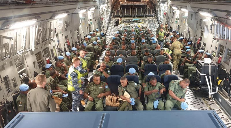 Members of the Republic of Fiji Military Forces deploying as part of the next rotation the United Nations Assistance Mission – Iraq take their seats on a Royal Australian Air Force C-17A Globemaster III in preparation for take-off. Photo by Captain Krystelle Jones.