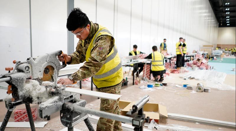 A British Army engineer works on fixings at the NHS Nightingale hospital in London's Docklands. UK MoD photo.