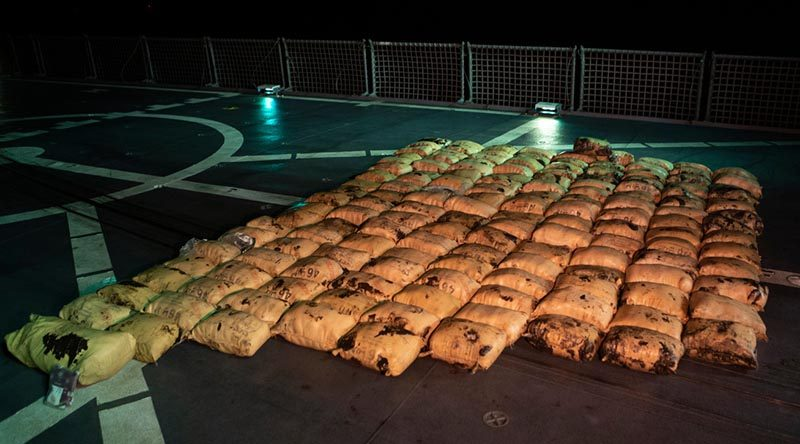 150 parcels of illicit drugs including hashish and heroin are made ready for destruction on the flight deck of HMAS Toowoomba after a successful boarding during Operation Manitou. Photo by Leading Seaman Richard Cordell.