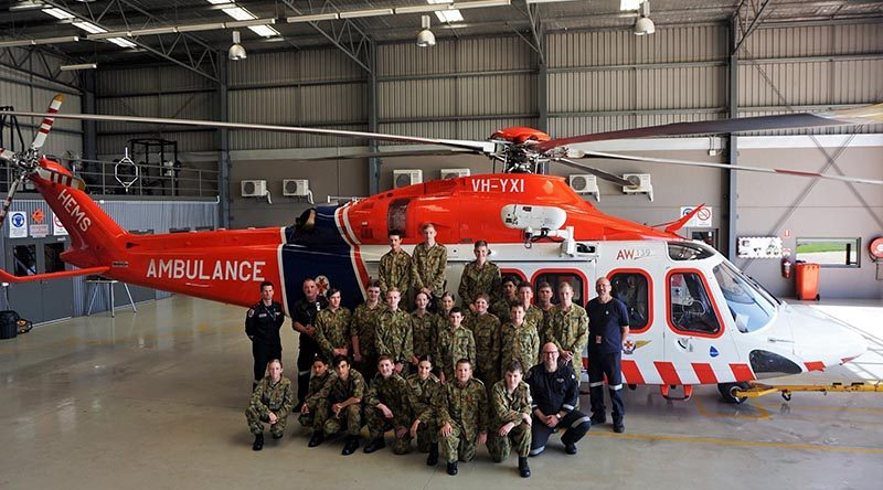 Air Force Cadets from Warrnambool's 413 Squadron with the HEMS4 AgustaWestland AW139 helicopter. The HEMS4 MICA Flight Paramedic Andrew Osborne is on the far left of the group. Photo by PLTOFF(AAFC) Jane McDonald.