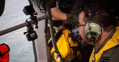 Deputy Director of Artificial Intelligence Wing Commander Michael Gan looks for a life raft off the Queensland coast during an assessment of the AI-Search system using GoPros for eyes. Photo by Corporal Jessica de Rouw.