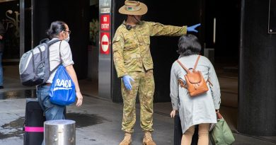 Australian Army soldier Private Claude Allan from 2nd/17th Battalion, Royal New South Wales Regiment, guides returning passengers to their hotel rooms in Sydney, as part of the government's COVID-19 response. Photo by Corporal Chris Beerens.