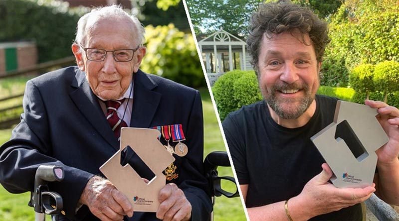 Captain Tom Moore and his singing partner – and favourite singer – Michael Ball show off their Number One charts award after their cover of You'll Never Walk Alone debuted at Number 1. Photo courtesy Official Charts web site.