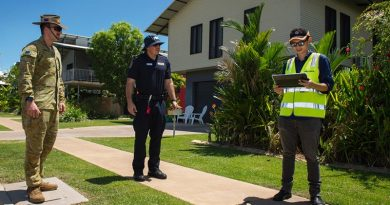 Australian Army soldier Lance Bombardier Jacob Homulos, Northern Territory Police Officer Senior Constable Maxwell Lisson and Department of Health Environmental Officer Jerry Chen conduct quarantine compliance checks in Darwin. Photo by Captain Carla Armenti.