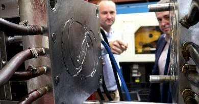 Axiom Managing Director Jim Grose and Ben Barona from Defence Science and Technology Group examine an injection moulding die used to manufacture face-mask components. ADF photo.