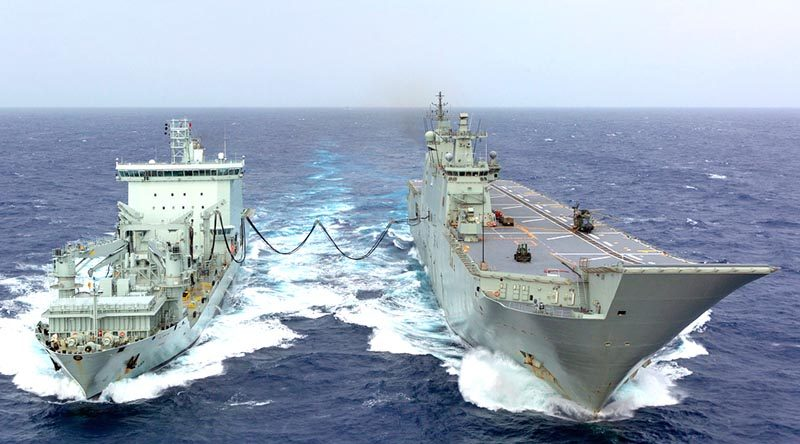 HMAS Adelaide conducts a replenishment-at-sea fuel transfer with Royal Canadian Navy supply ship MV Asterix during the sea phase of Exercise RIMPAC 18. Photo by Able Seaman Ronnie Baltoft.