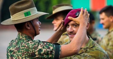 Australian Army soldier Private Jeremy Thomas of the 3rd Battalion, Royal Australian Regiment, swaps headdress with a Malaysian soldier following a Kapyong Day commemorative service in Malaysia during Indo-Pacific Endeavour 2019. Photo by Leading Seaman Jake Badior.
