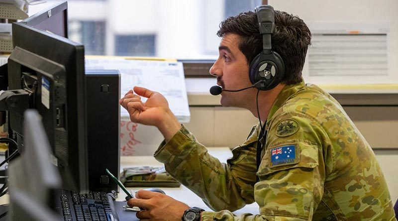 Australian Army soldier Lance Corporal Henry Hudson at the NSW Health COVID-19 Trace Contact Centre. Photo by Corporal Chris Beerens.