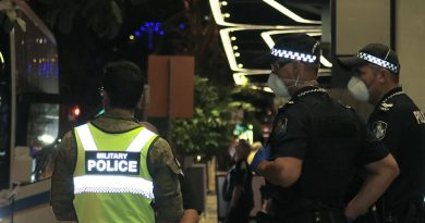 Australian Army military police and Queensland police stand guard outside The Westin, Brisbane, as more  more Aussies coming off overseas flights arrive for quarantine. Photo by CONTACT stringer Christabel Migliorini.