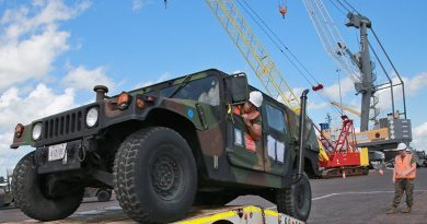 US Marines with Marine Rotation Force - Darwin load a Humvee at East Wharf Port Darwin. US Marine Corps photo by Lance Corporal Natalie Greenwood.