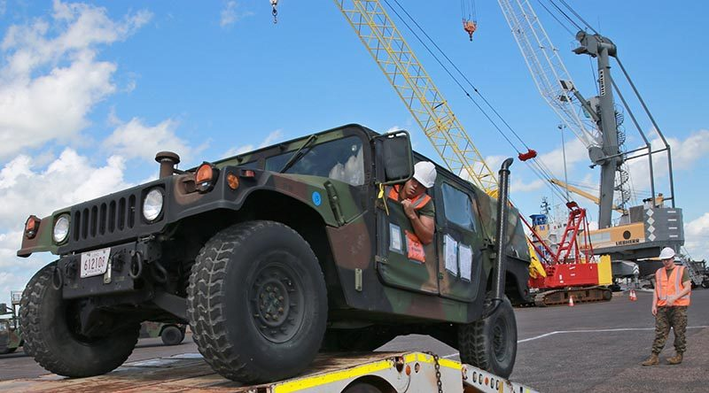 US Marines with Marine Rotation Force - Darwin load a Humvee at East Wharf Port Darwin. US Marine Corps photo by Lance Corporal Natalie Greenwood.