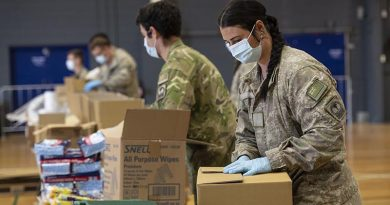New Zealand Defence Force personnel from Palmerston North help pack more than 2500 care packages for families in need in remote areas. NZDF photo.
