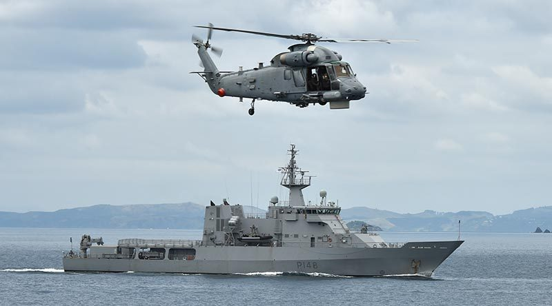HMNZS Otago, pictured with a Seasprite helicopter hovering overhead, is one of four Royal New Zealand Navy ships that will be visible in the Hauraki Gulf over the next few weeks as they carry out training essential to maritime operations. RNZN photo.